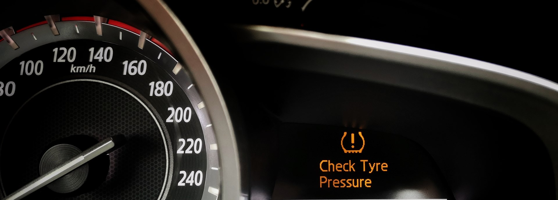 car dashboard is highlighting the check tyre pressure light is on